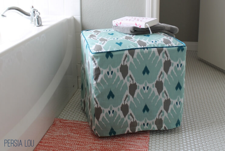Then just flip your cover right side out and slip it onto the ottoman.  Woot! All done. - Simple Ottoman Slipcover - Persia Lou