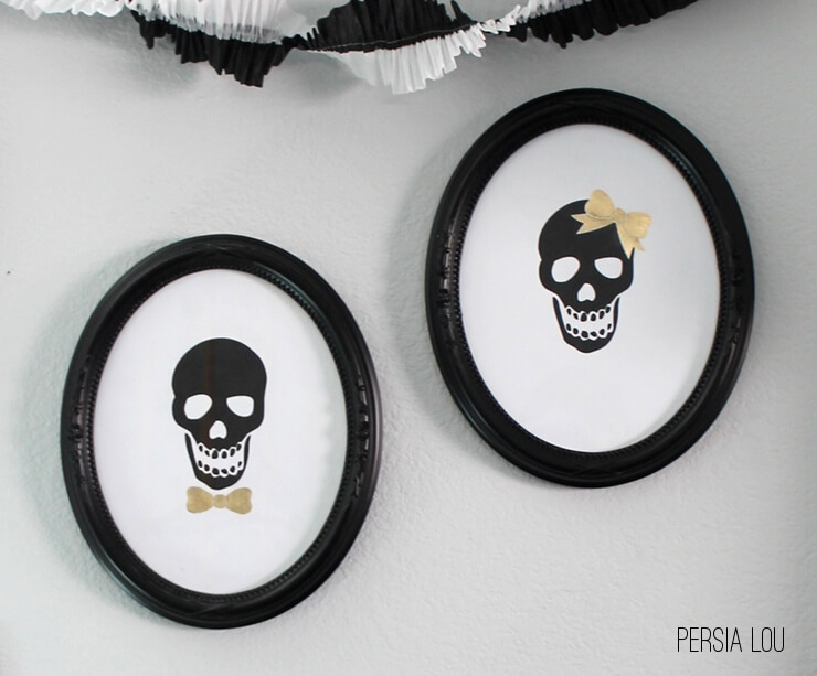 i had some great oval frames that werent currently being used but mr and mrs skull remedied that situation right away - Halloween Skulls