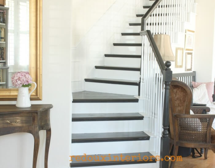 Black-and-White-stairs-french-stained-entry-table-reoduxinteriors