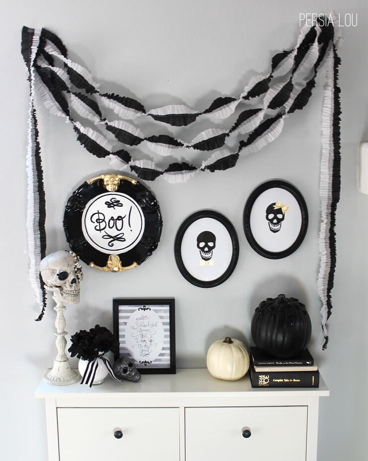 black and white halloween mantel