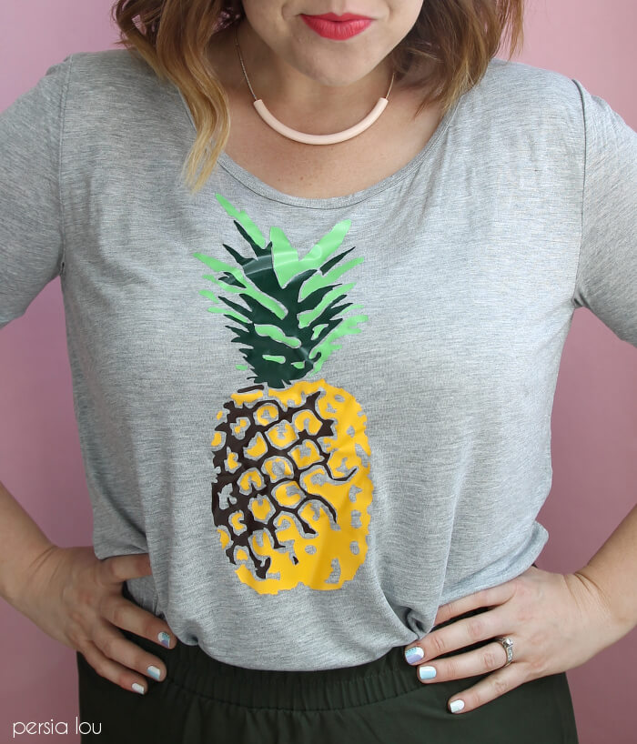 Make your own multi-colored pineapple t-shirt using heat transfer vinyl.