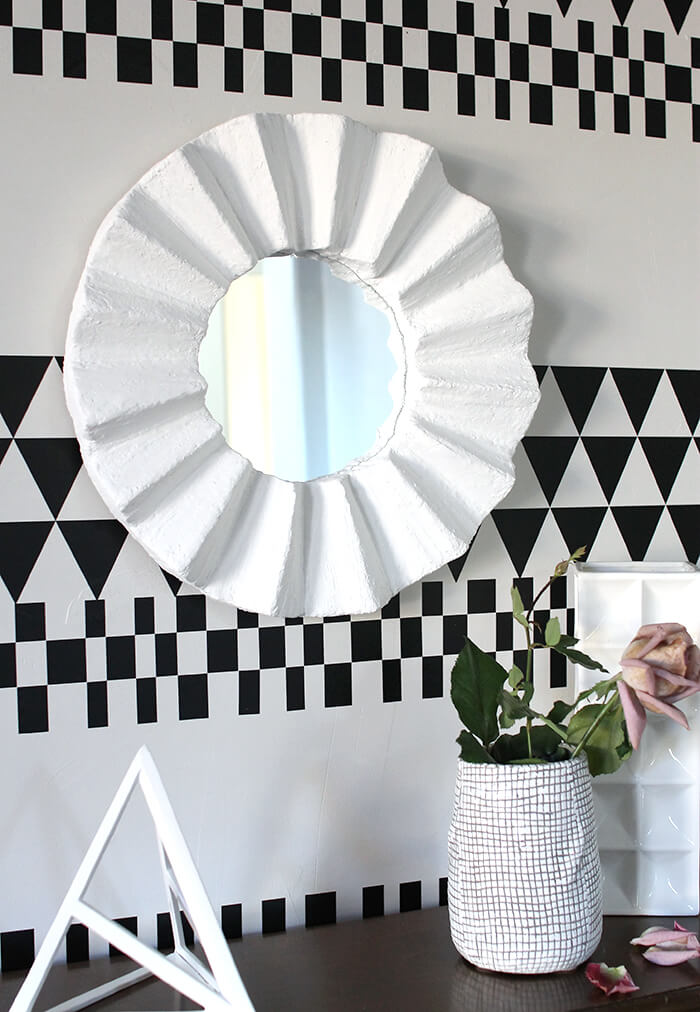 make your own fluted round mirror - love the high-end plaster look