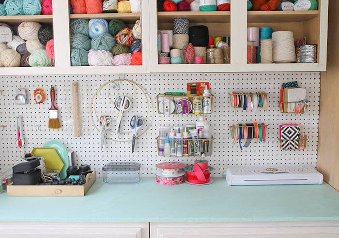 A colorful and organized craft room - lots of fun storage ideas!