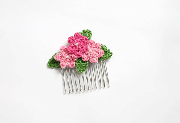 Make your own pretty Crochet Flower Hair Combs with tiny crocheted flowers. Free crochet pattern and photo tutorial.