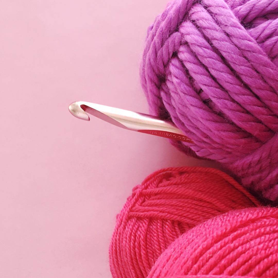 pink yarn and crochet hook