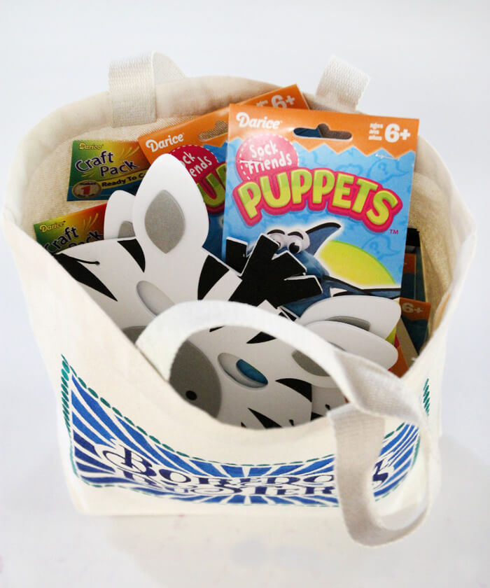 kids boredom busters bag full of craft kits and activities