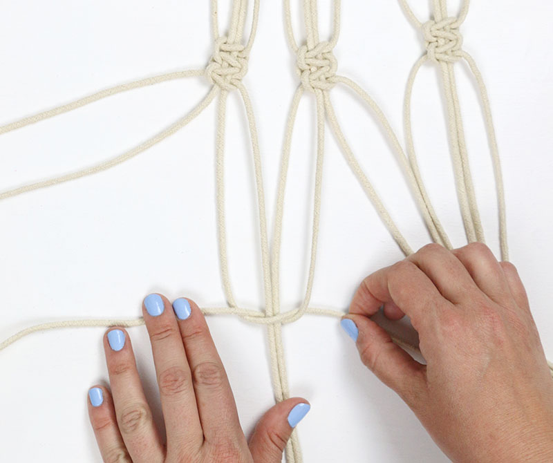 tie second row of knots - diy macrame plant hanger