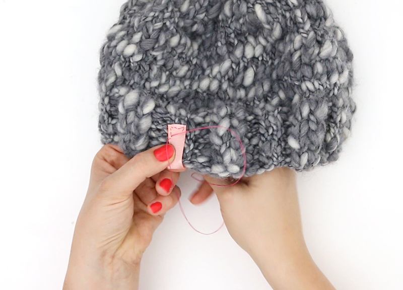 thick and thin knit hat - sewing on tag
