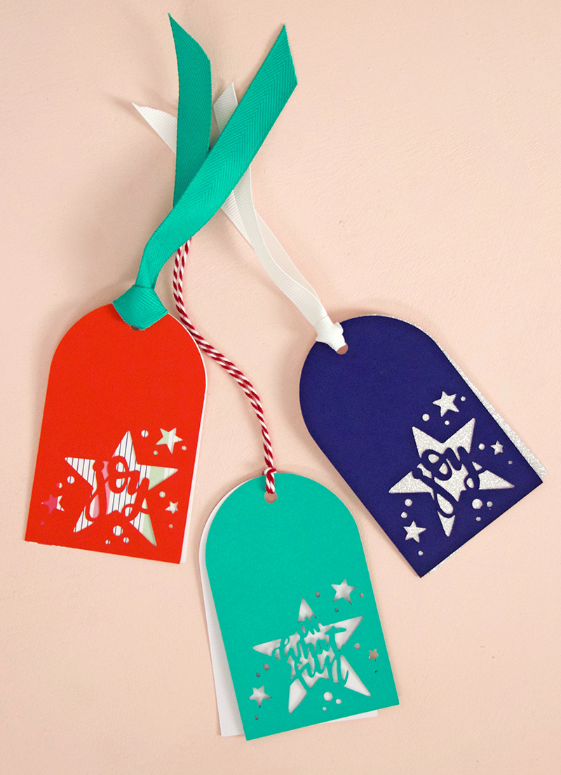 make these cut paper cut christmas tags with your silhouette or cricut