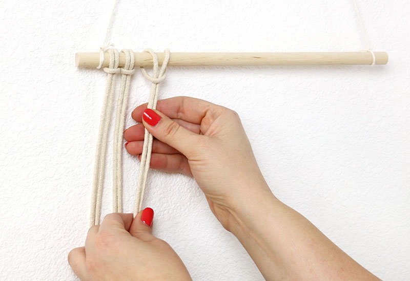 attach cords with larks head knot for macrame wall hanging