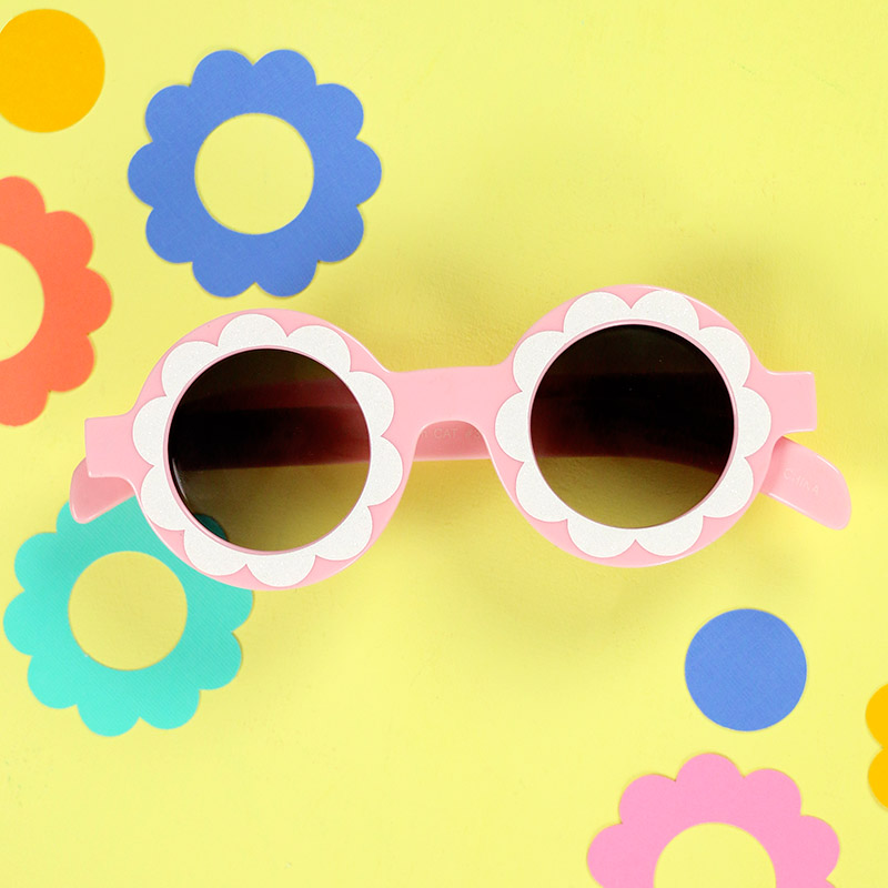 finished diy flower sunglasses on table