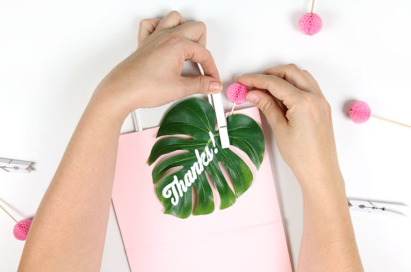 attach to tropical leaf to party favor gift bag