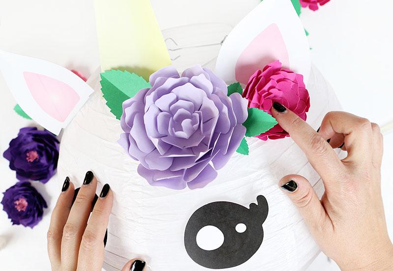add flowers to unicorn lantern diy unicorn party decorations
