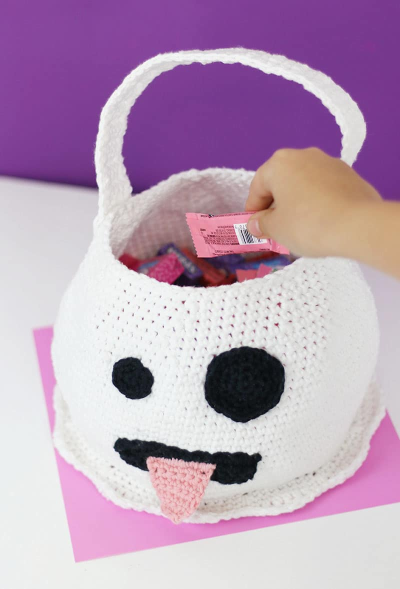 ghost emoji trick or treat crochet bag filled with candy
