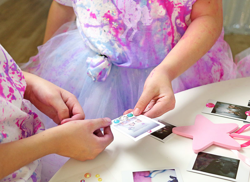 decorating photos at unicorn party
