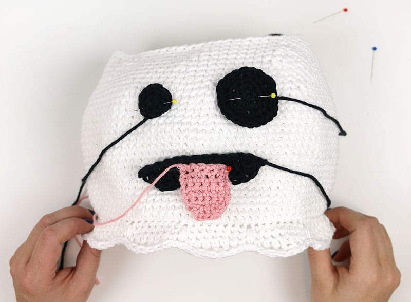 position ghost face pieces on crochet ghost bag