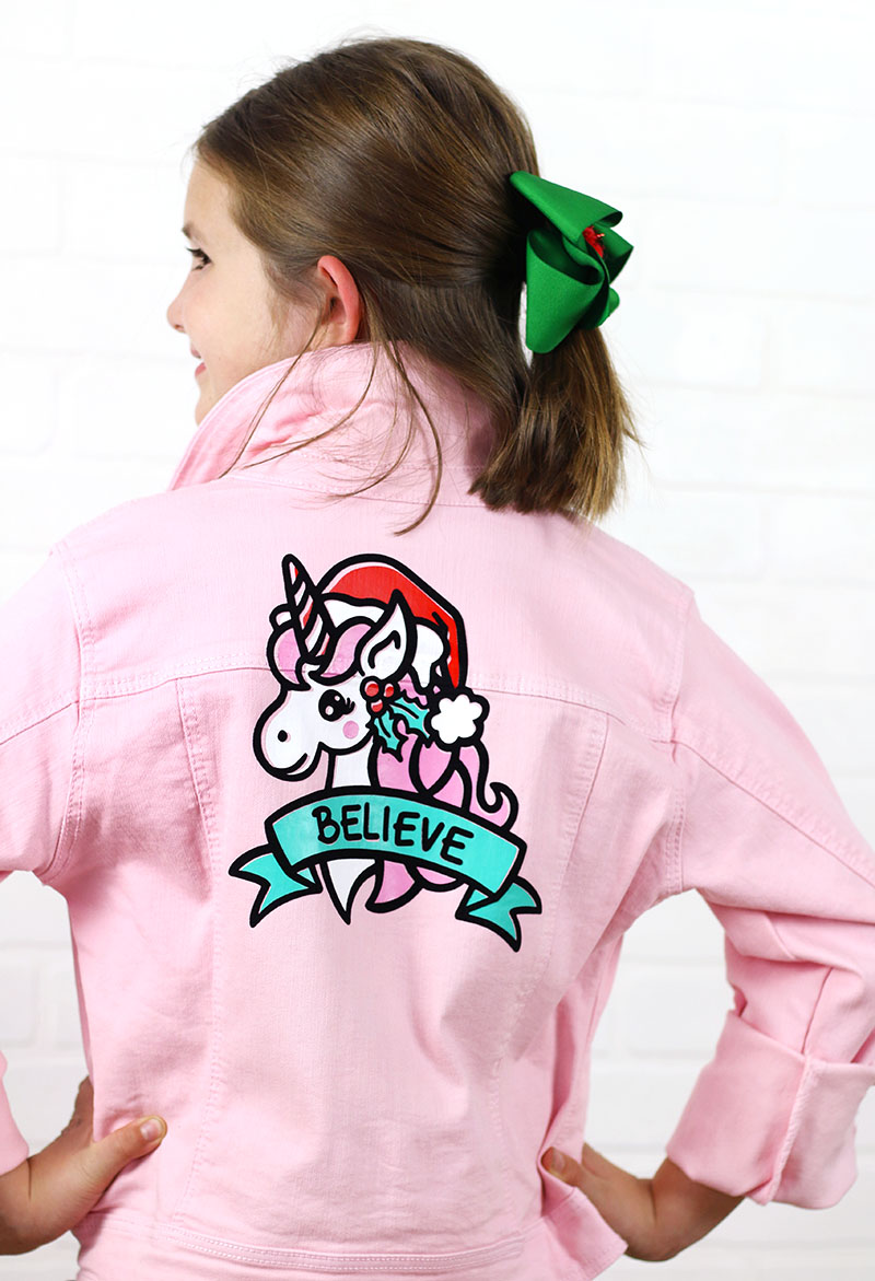 believe christmas unicorn cut file for silhouette cricut on pink jacket