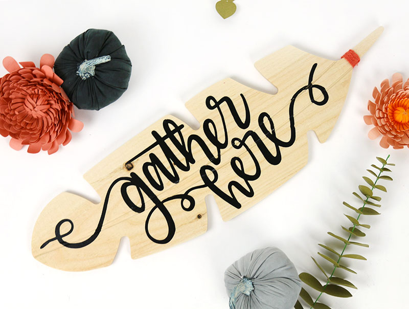 gather here wooden feather sign