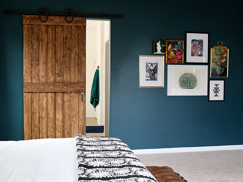 dark teal bedroom gallery wall