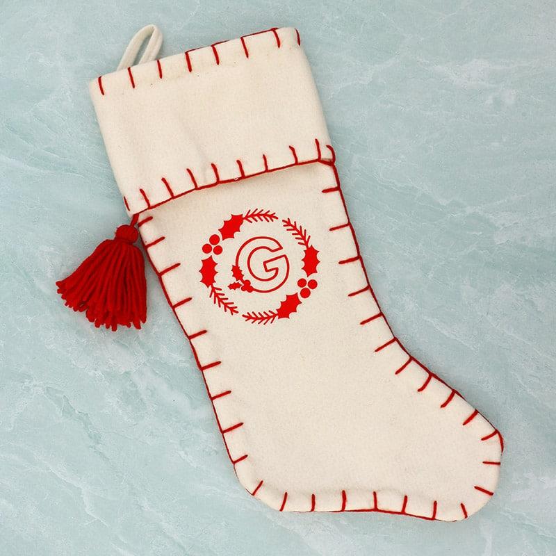white felt stocking with diy red vinyl monogram