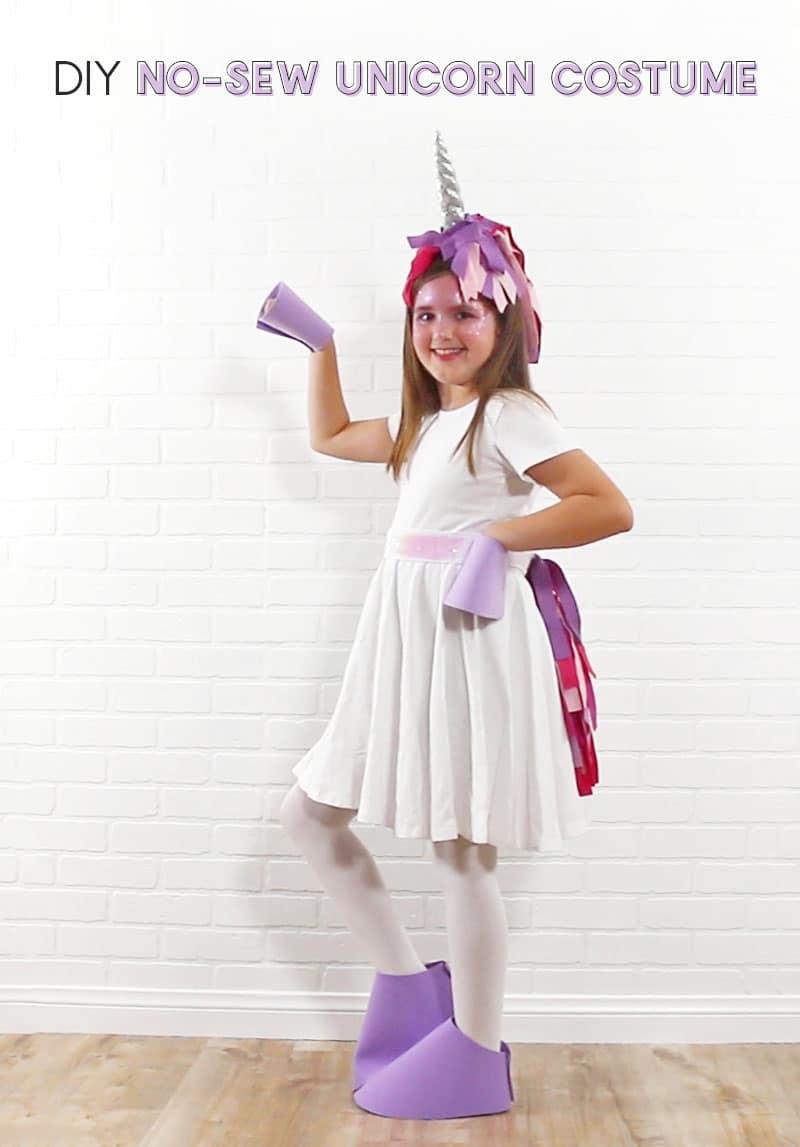 DIY Easy No Sew Unicorn Costume - girl wearing white dress and pink and purple DIY unicorn costume