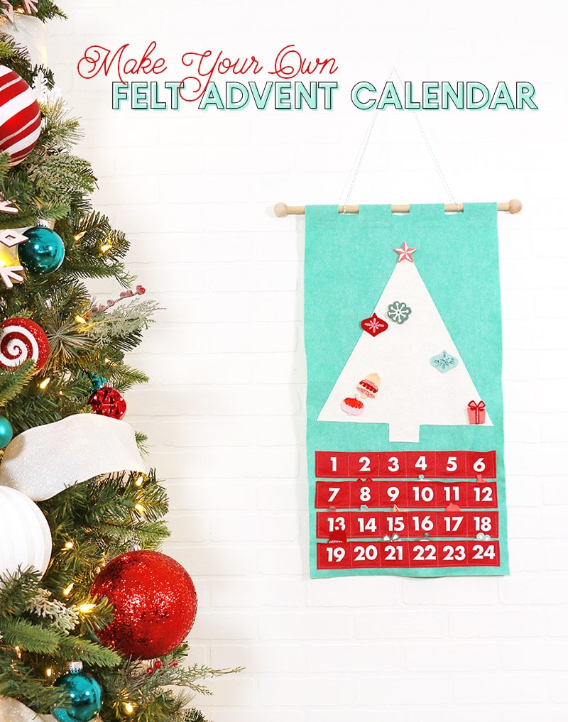 DIY Christmas tree advent calendar made from green and red felt hanging on white wall next to decorated Christmas tree.