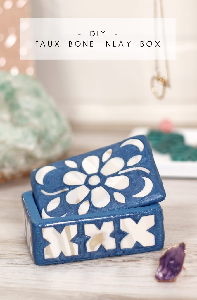 small blue trinket box with a white mosaic design