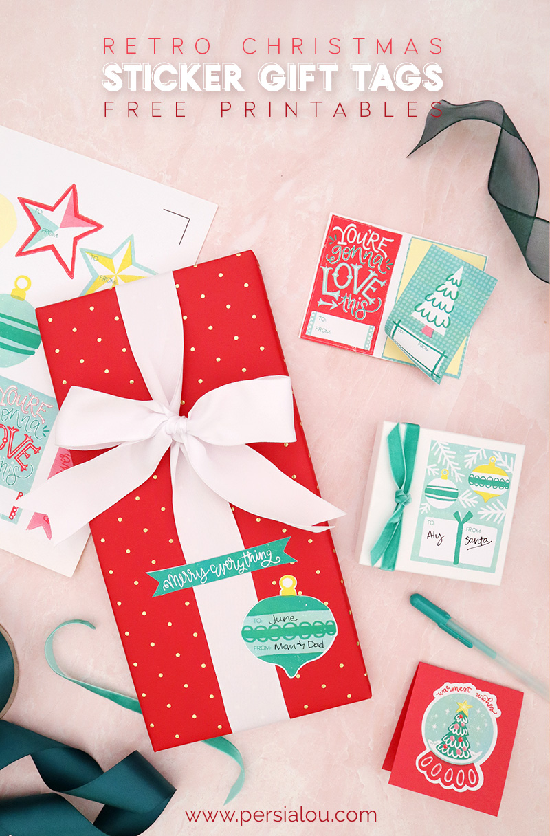 red and green wrapped christmas gifts and printed sticker tags on a light pink background