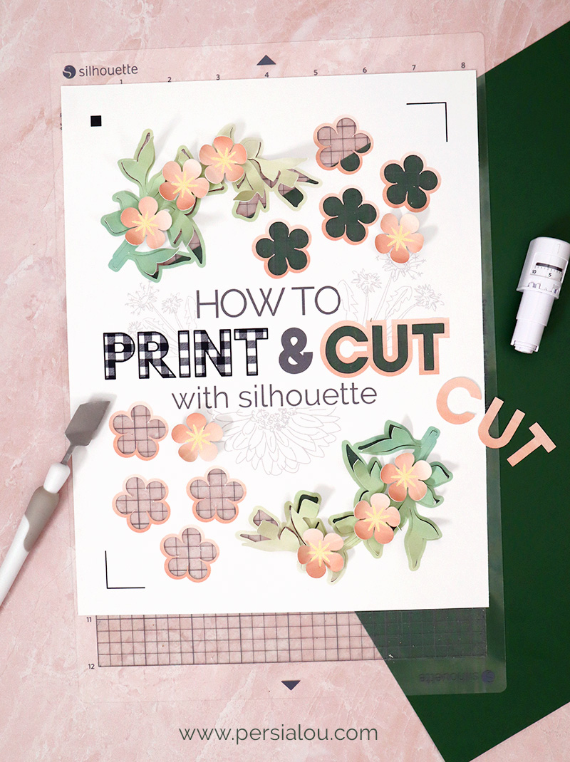 white cardstock on silhouette cutting mat with words printed and cut out of the cardstock reading how to print & cut with silhouette paper flowers and other craft supplies surround the cutting mat