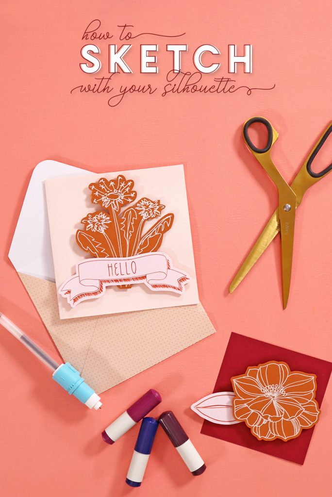 "Blush pink note card with burnt orange floral design element on the front of the card in front of a light pink polka dotted envelope. The notecard is surrounded by a pair of gold scissors, Silhouette sketch pens, a gel pen in a Silhouette pen adapter, and a piece of dark red paper with a burnt orange floral design on it. All of these items are arranged on a coral background. Text at the top of the image reads, ""How to Sketch with your Silhouette."""