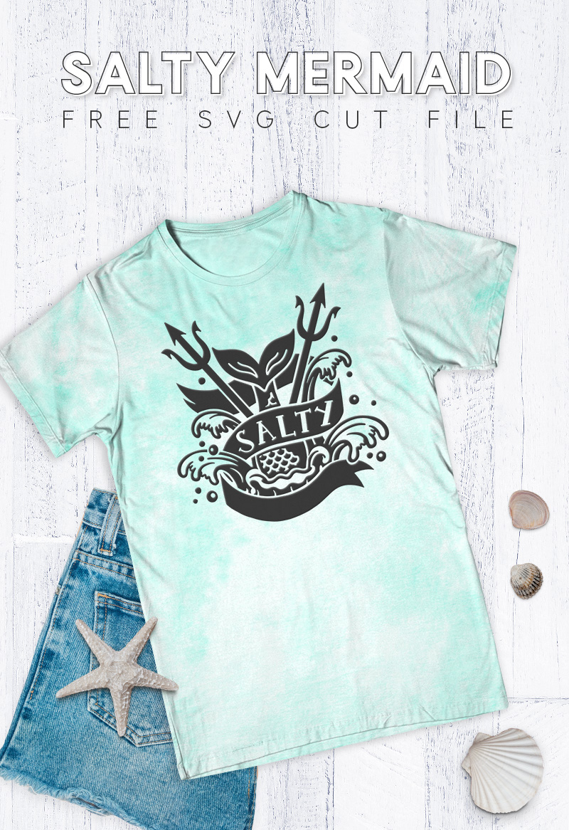 """Mint green tie dye t-shirt with black design on the front in a tattoo style of a mermaid tail splashing into the water. The banner around the mermaid tail reads, """"Salty."""""""